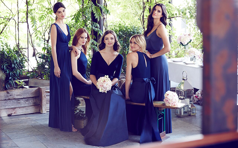 bridesmaids wearing royal purple dresses