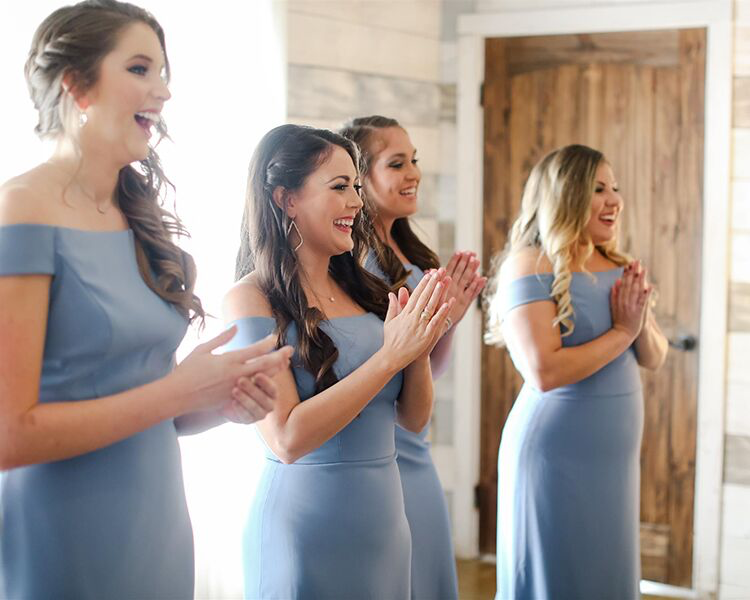 excited bridesmaids clapping hands