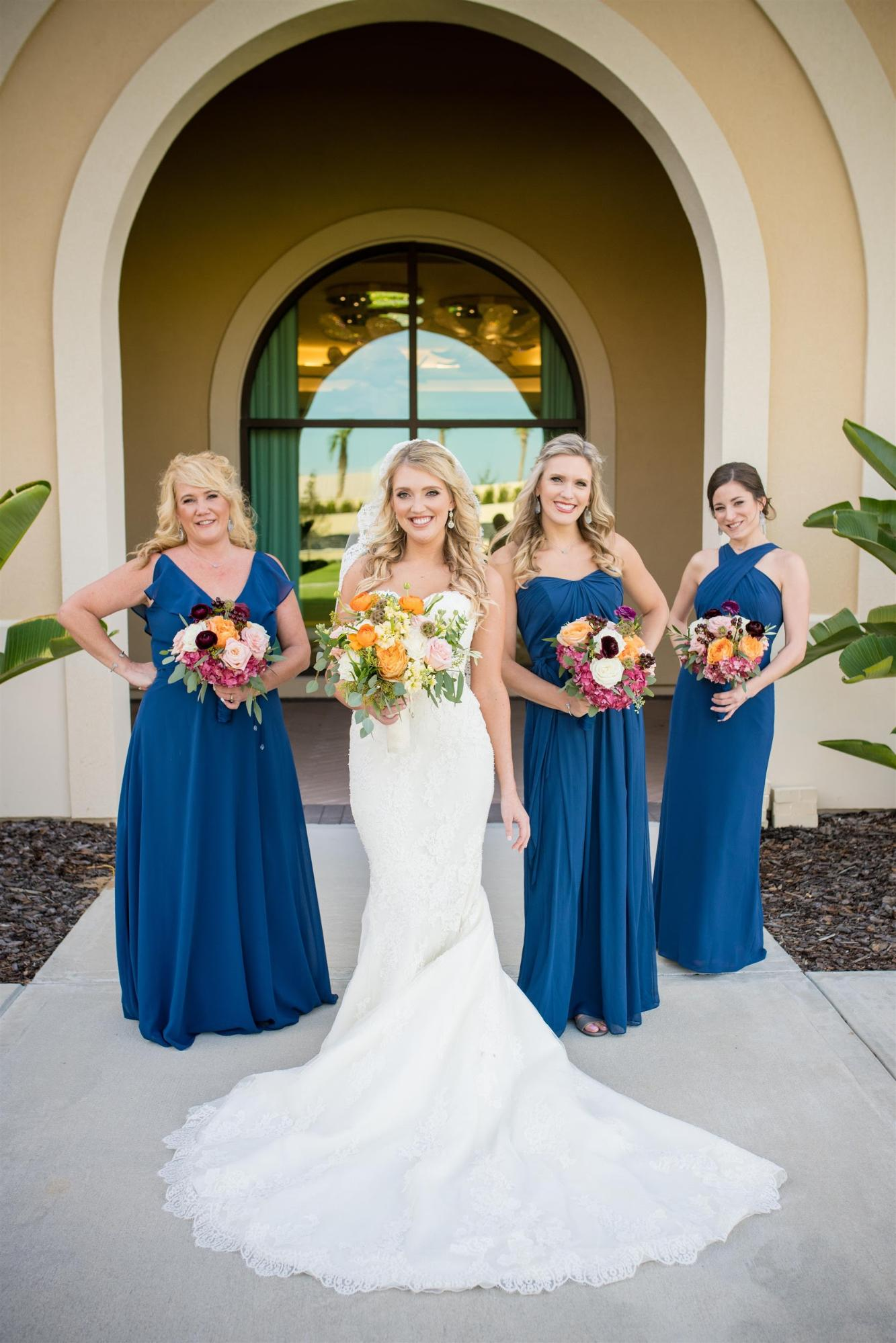 Not keen on a big, expensive wedding? We don't blame you one bit. Learn how to plan a small wedding that keeps the guest count low and the wow factor high! Dessy Real Wedding Photo by William Arthur Photography | Royal Blue Bridesmaid Dresses | Classic Blue Wedding