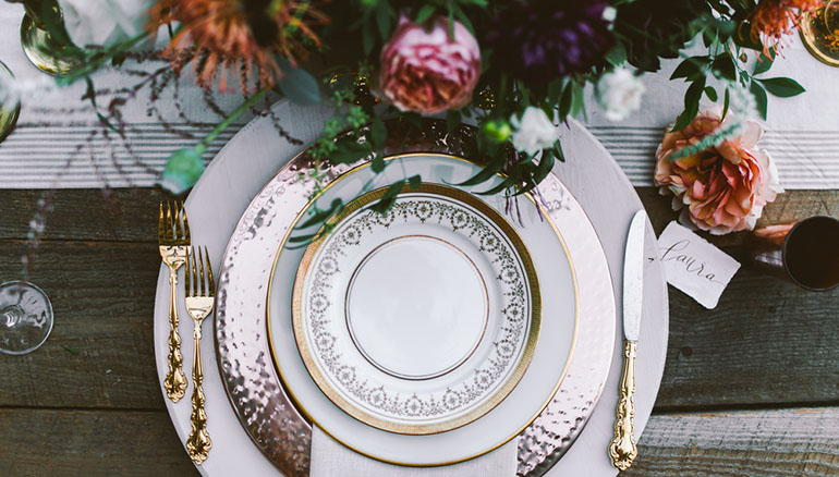 wedding place setting with gold trimmed plates