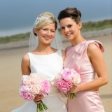 bride and bridesmaid with pink roses bouquets