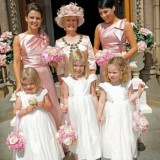 mother of bride and bridesmaids in pink outside church
