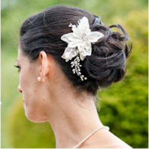 brunette bride with wedding updo hairstyle
