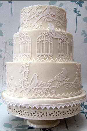 lace wedding cake with birds and birdcages