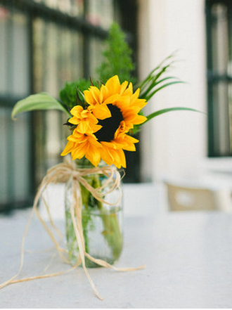 Sunflowers In Jam Jars As Decorations
