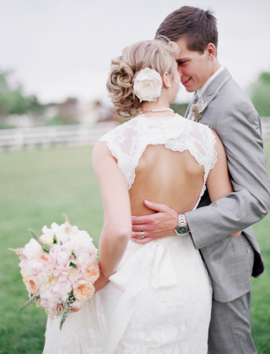 bride in lace backless wedding gown