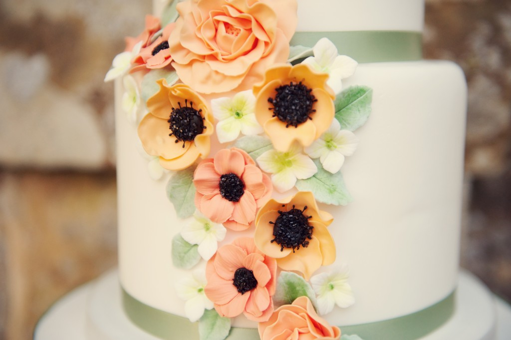 wedding cake decorated with coral and peach colours