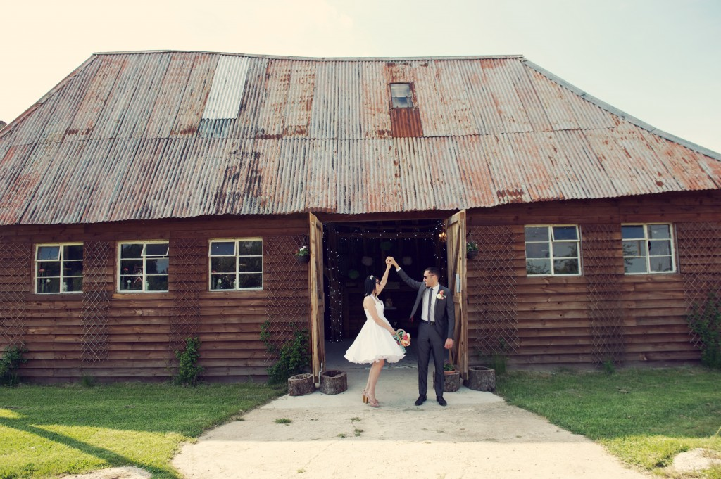 bride and groom outside rustic barn