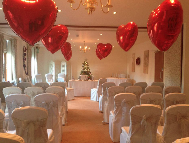 red balloons lining wedding aisle