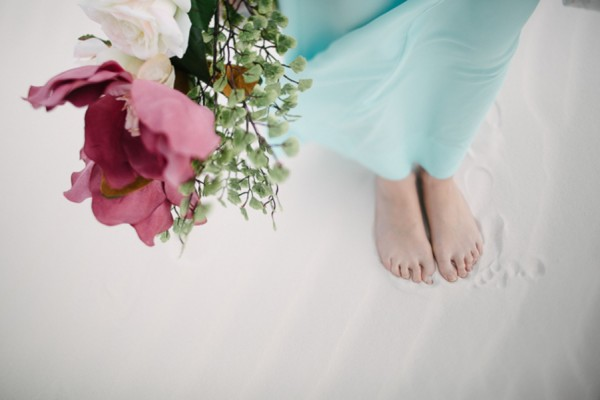 barefoot bride at beach wedding